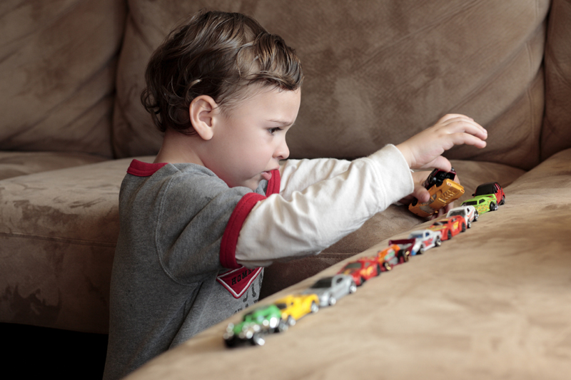 autistic-boy-with-cars