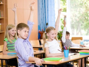 students-raising-hands_shutterstock_210797458